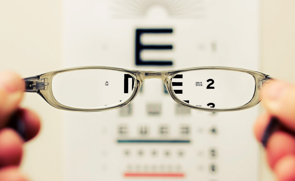 Glasses make letters clear on an eye test board - Robin Hall Opticians  Photo by David Travis on Unsplash